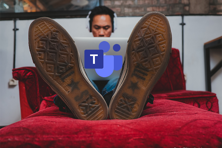 Image: Microsoft Teams Home working man lying on bed with laptop