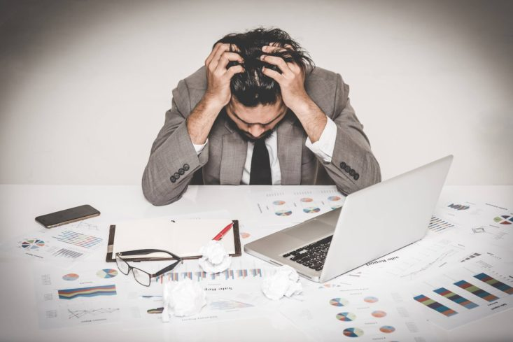 Image: Man holding his head in stressed pose