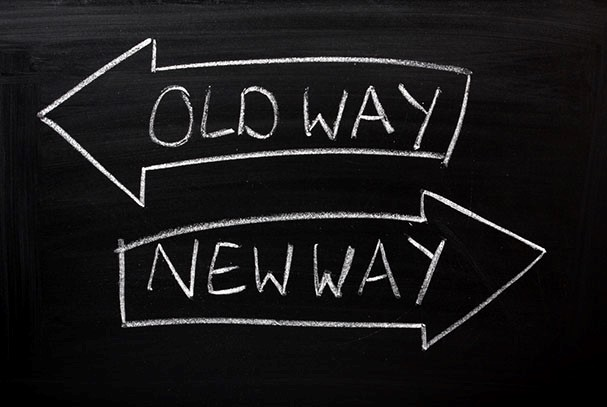 Image: Chalkboard with arrows pointing in different directions - old way, new way