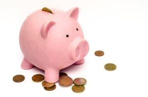 Image: pink piggy bank and coins